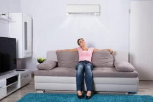 Woman relaxing with air conditioning